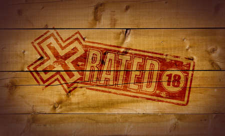 explicit: X Rated stamp on wooden background