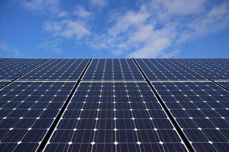 Solar panels against blue sky photo