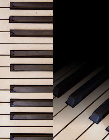 music book: Aged piano keys on black background