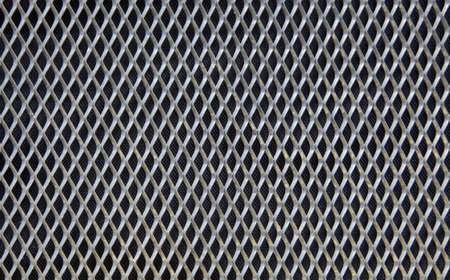 construction mesh: Shiny metal grill on a black background Stock Photo