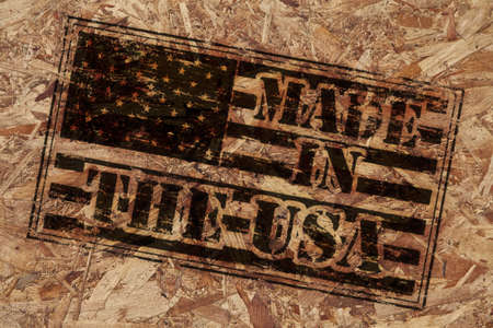 Made in the USA stamp on rough wooden background photo