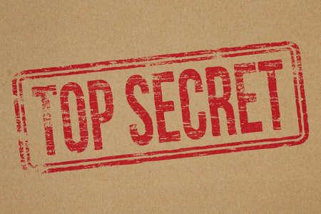top secret: Top secret rubber stamp impression on brown paper background Stock Photo