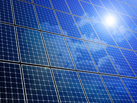 Array of solar panels with blue sky reflection Banque d'images