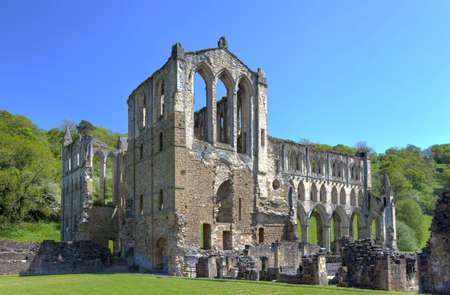 abbey ruins abbey: Rievaulx Abbey. Ruins near Helmsley in North Yorkshire Stock Photo