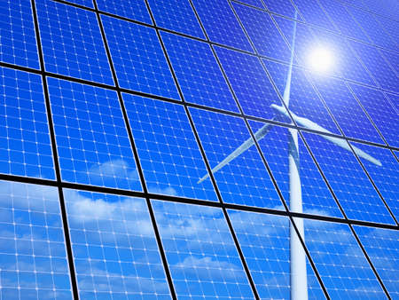 Array of solar panels with wind turbine reflection Stock Photo