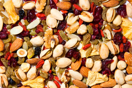 energy mix: Healthy mixed dried fruit and nuts background