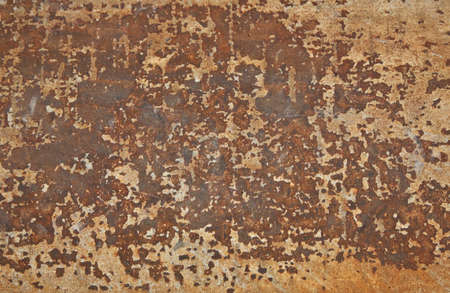 corroded: Rusty old metal panel with decaying and corroded surface