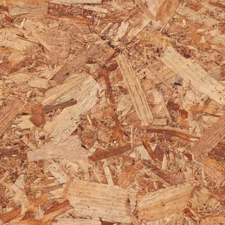 tileable background: Repeating tileable rough wooden chipboard background. Seamless image that repeats left, right, up and down Stock Photo