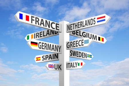 europe: Europe destinations and flags signpost against blue sky