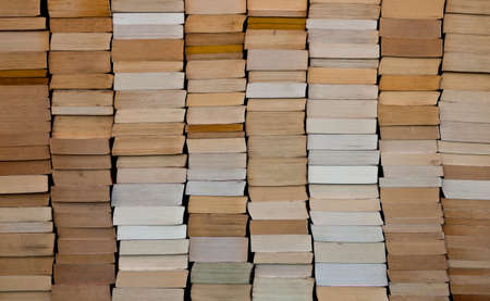 Pile of paperback book ends stacked background Stock Photo
