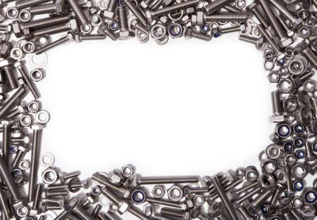 metal fastener: Stainless steel nuts, bolts and washers surrounding a white background