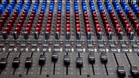 recording: Recording studio audio mixing desk knobs and sliders