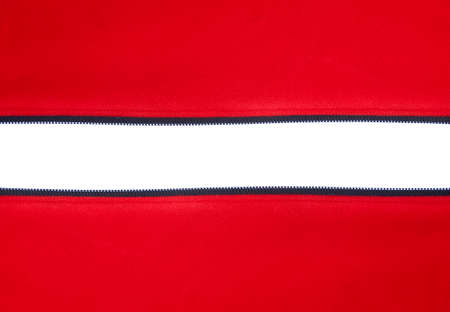 zipped: Open horizontal zipper on red material against white background