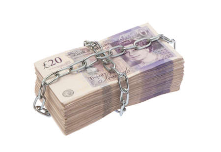 bank note: Uk twenty pound bank notes pile in chains Stock Photo