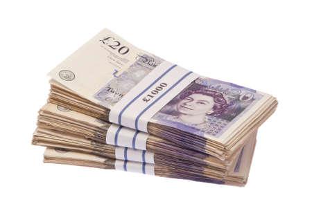 stash: Isolated pile of twenty pound bank notes in one thousand pound bundles