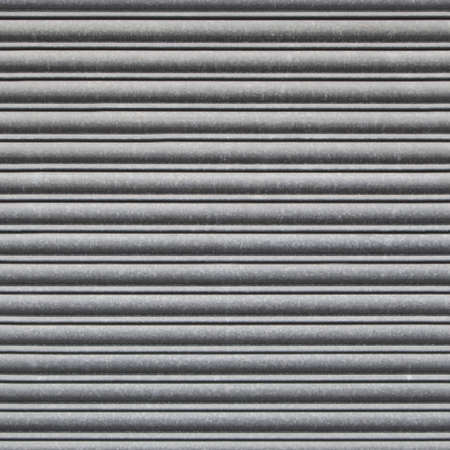 security shutters: Repeating Metal Shutter Background. Tileable wallpaper background that repeats left, right, up and down Stock Photo