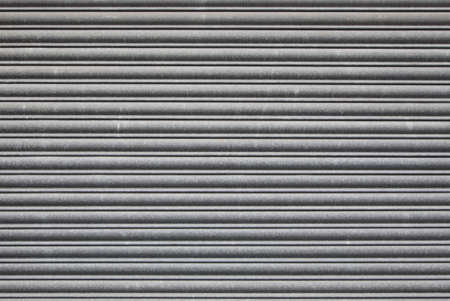shutter door: Metal roller shutter door. Security grill background Stock Photo