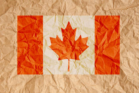 scrunched: Canada flag. Canadian flag on crumpled brown paper background.