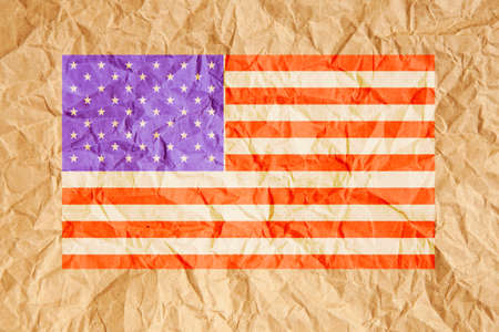 scrunched: United States of America, USA flag. American flag on crumpled brown paper background.