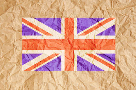 scrunched: United Kingdom, UK flag on crumpled brown paper background.