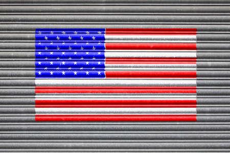 shutter door: USA Metal Shutter. American flag on metal roller shutter door Stock Photo