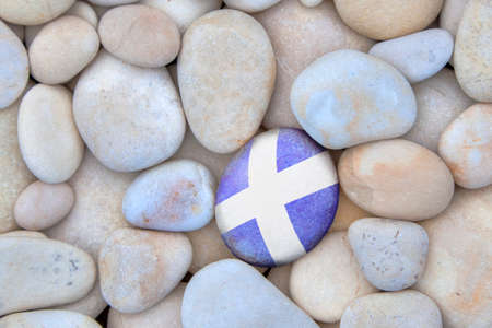 scottish flag: Scotland Pebble. Scottish flag pebble amongst white pebbles. Stock Photo