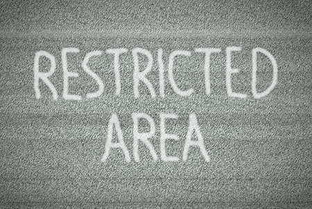 restricted area: White noise on tv screen with restricted area sign