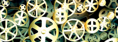 engineered: Dirty old gear wheels industrial background banner Stock Photo