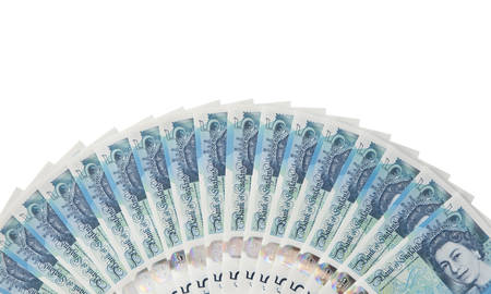 fanned: New English plastic five pound note fanned out isolated against white background Stock Photo