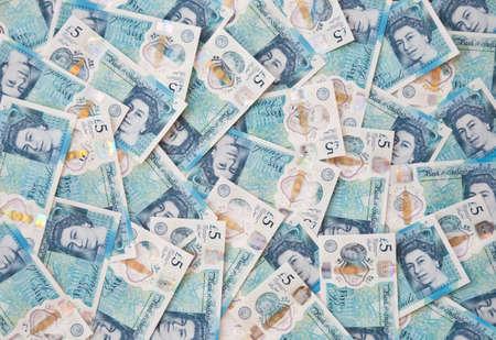 british english: New English plastic five pound note background Stock Photo