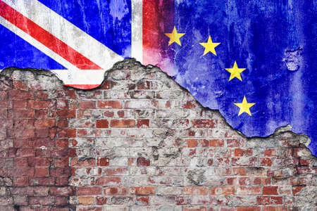 Grungy wall with painted UK and European Union flags flaking off Stock Photo