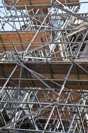 Tower of scaffolding up against a church tower Zdjęcie Seryjne