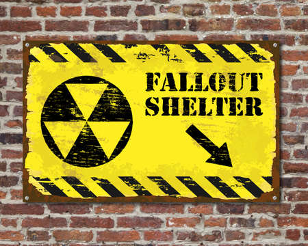 Grungy fallout shelter sign on brick wall