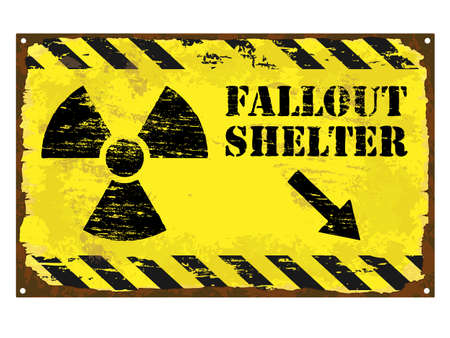 Grungy rusted enamel fallout shelter with radiation symbol sign