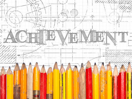 Achievement hand drawn sign and line of old pencils
