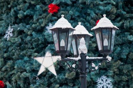 snowy city light and christmas tree photo