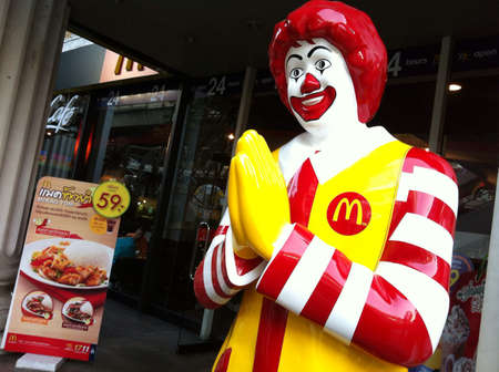 mcdonald: McDonald mascot sawasdee doing Thai style greeting.