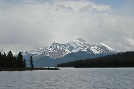 winter sunrise: snow mountain and calm lake