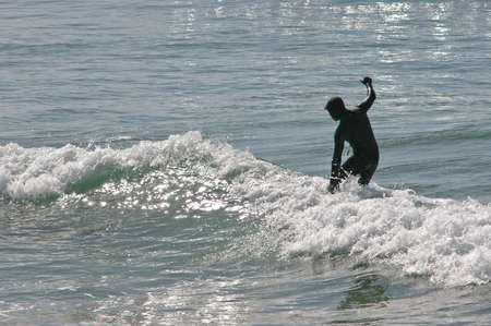 finesse: surfer on the sunny beach