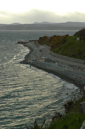 winding road nearby ocean in evening photo