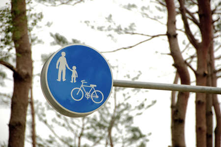 family and bicycle traffic sign in blue photo