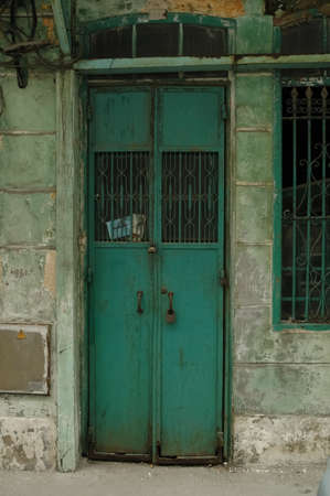 rustic green metallic door in China photo