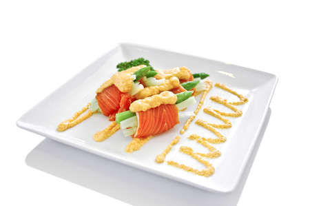 Gourmet smoked salmon and asparagus rolls Japanese style isolated photo