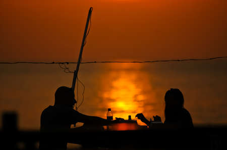 romantic couple dating at sun set photo
