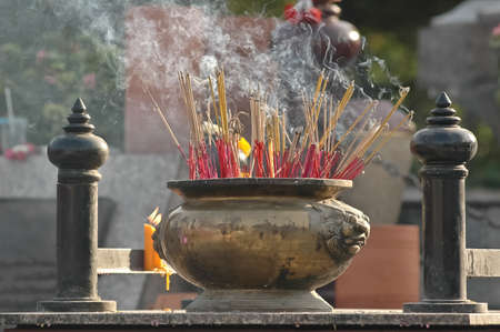 bucket of fragrance sticks in Chinese temple photo