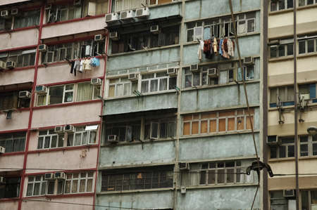Aged slum units on high rise apartments in central Hong Kong