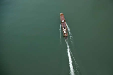 indo china: Top perspective of Thai ancient wooden speed boat on emerlad river Stock Photo