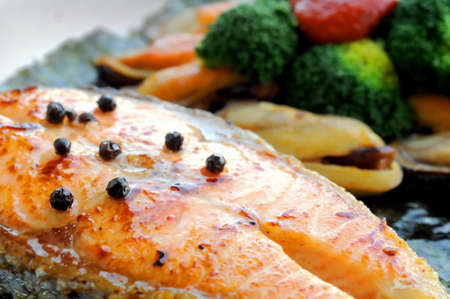 Australian salmon fillet steak grilled with New Zealand mussels salad photo