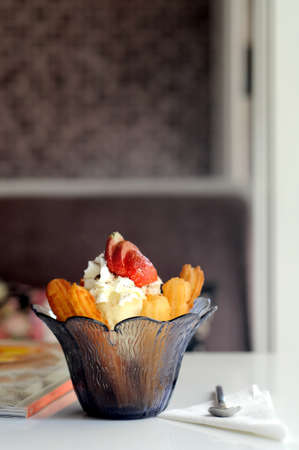 churros: Churros with strawberries vanilla icecream Stock Photo