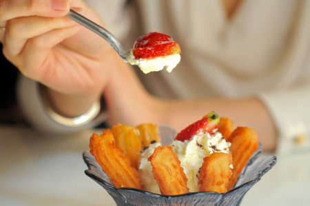 Eating strawberries vanilla icecream and Spanish churros photo
